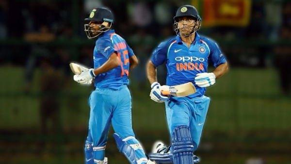 Bhuvneshwar Kumar and MS Dhoni take a single during the second ODI against Sri Lanka.