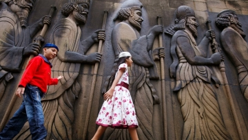 Parsi children touch the walls of a Parsi fire temple in Mumbai. Image used for representational purpose only.
