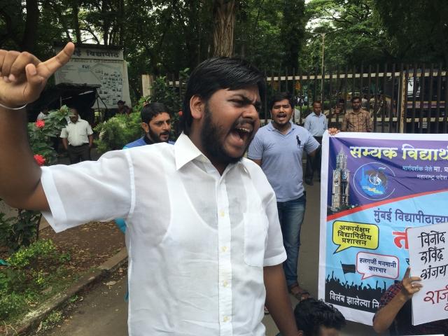 Saroj Bansode protests outside Mumbai University campus.