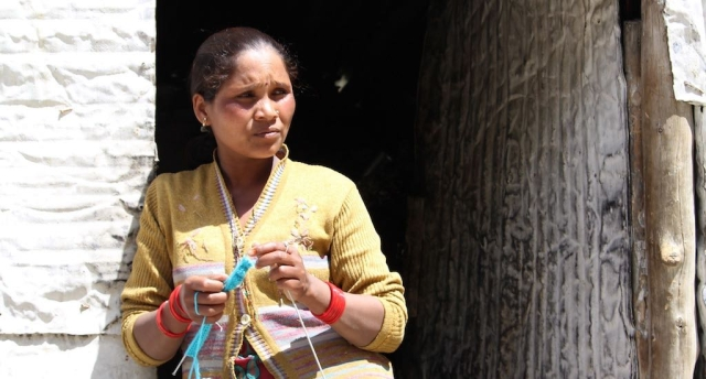 Neerja Ho from Jharkhand, seen knitting a sweater for her 4-year-old daughter, faces more problems as a woman.
