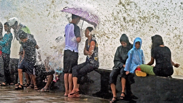 People sit at Worli during high tide. Image used for representational purposes.