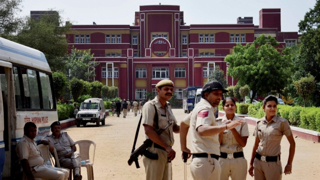 File photo of police stand guard at Ryan International School during a protest, in Gurugram on 9 September.