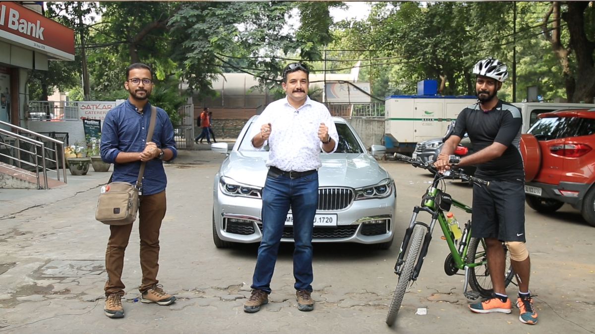 A cycle challenges a BMW 7-Series and the Delhi Metro Rail to a race.