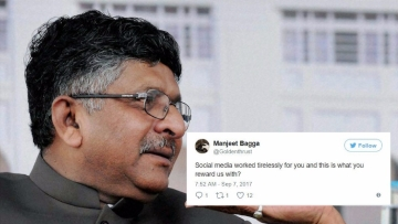 "Ravi Shankar Prasad, a BJP minister himself, was trolled for ""bowing down"" to ""liberal bullies""."
