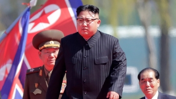 In this file photo dated April 13 2017, North Korean leader Kim Jong Un (centre) arrives for the official opening of the Ryomyong residential area, in Pyongyang, North Korea.<a></a>