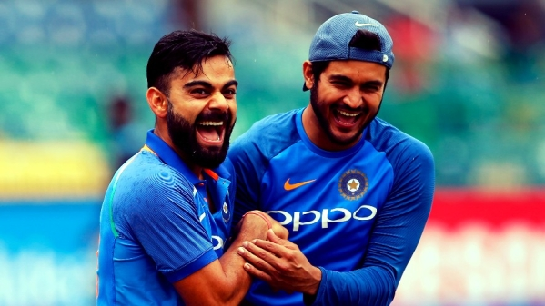 Virat Kohli shares a laughs with Manish Pandey during a training session.