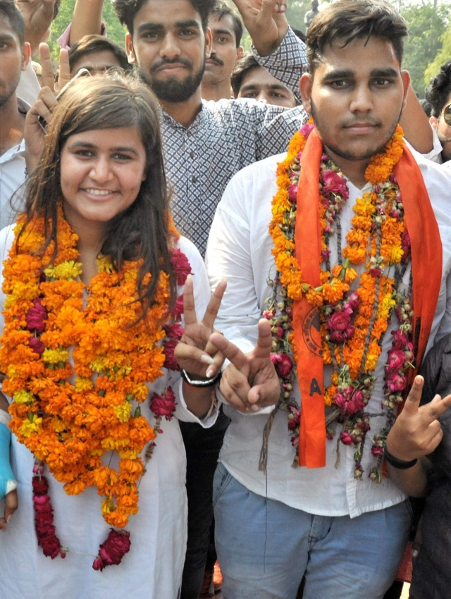 ABVP's  Mahamedha Nagar and Uma Shankar  (R) flash victory signs after winning the Secretary and Joint Secretary  posts in DUSU 2017 elections.