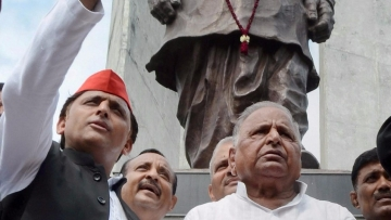 Samajwadi Party founder Mulayam Singh Yadav and party president Akhilesh Yadav after paying tributes to Ram Manohar Lohia on his 50th death anniversary at Lohia Park in Lucknow on Thursday.