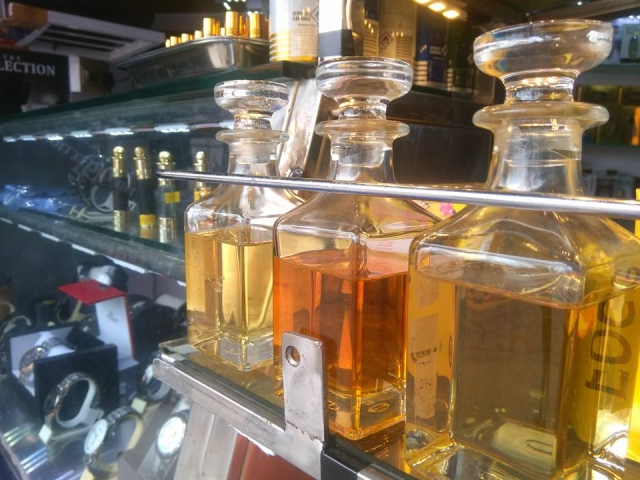Handmade fragrances made from essential oils displayed at a handicraft store.