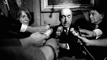 File photo of Pablo Neruda talking with reporters after being named the 1971 Nobel Prize winner for Literature