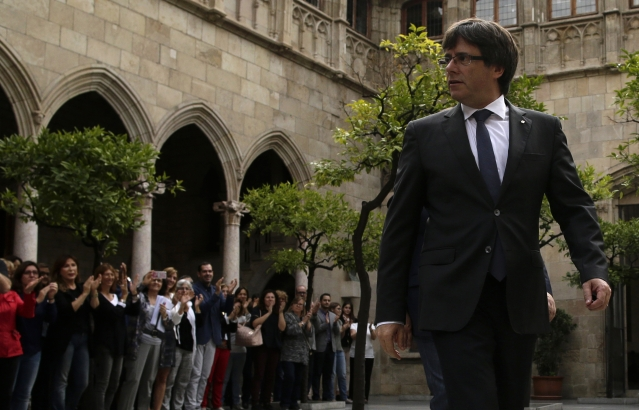Catalan President Carles Puigdemont arrives for a government meeting at the Palau Generalitat in Barcelona, Spain on Monday, 2 October 2017.