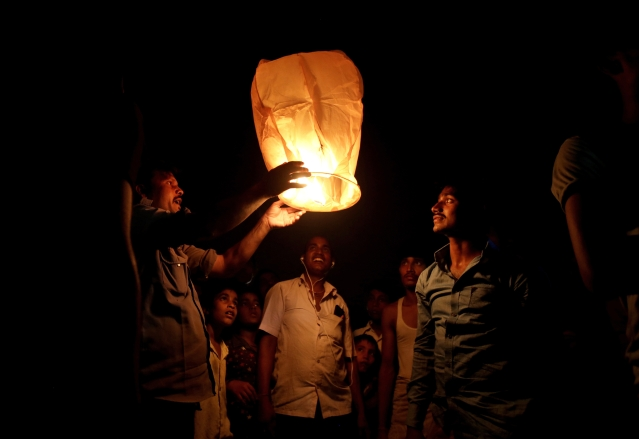 Indians light a sky lantern to celebrate Diwali festival in New Delhi, India, Thursday, Oct. 19, 2017.
