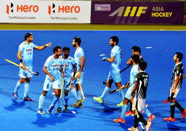 Indian players celebrate a goal during the Asia Cup match against Pakistan.