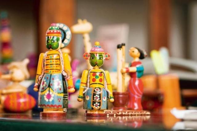 A colorful set of handmade Channapatna toys at display.