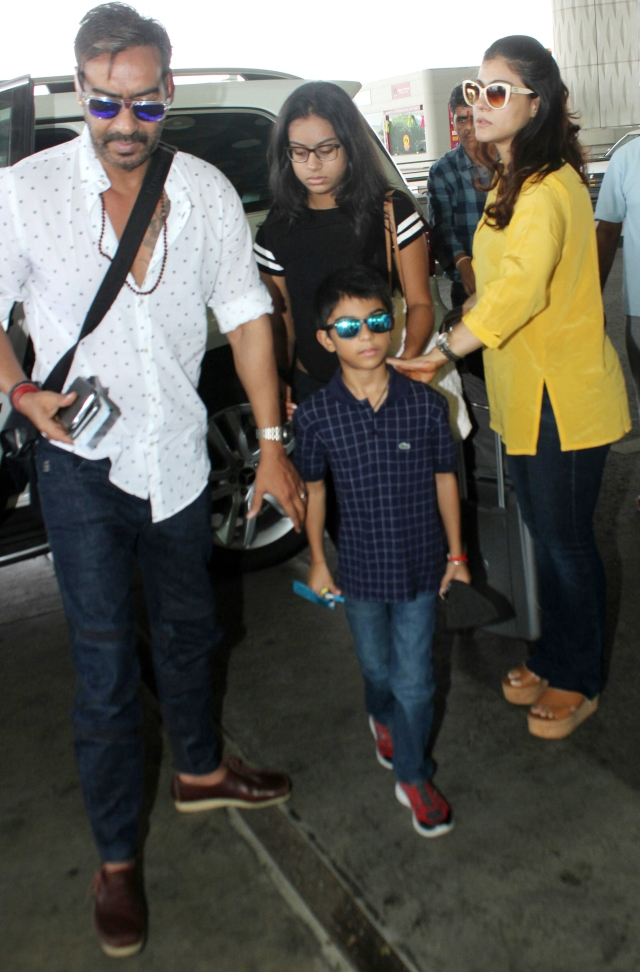 Ajay Devgn and Kajol were spotted at the airport with their kids.