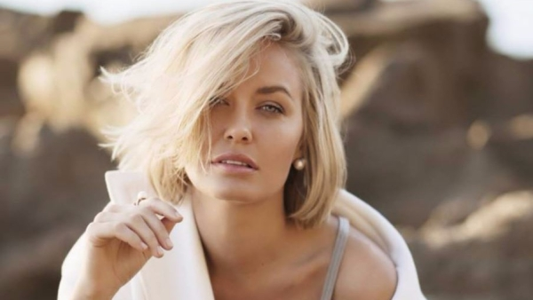 A fake handle of Lara Bingle accused Pakistan Opposition leader Imran Khan on Twitter of sexually harassing her.