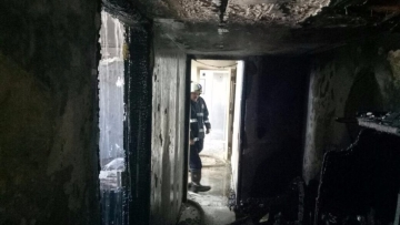 Fire-fighters entering the 13th floor after the outbreak of the fire.