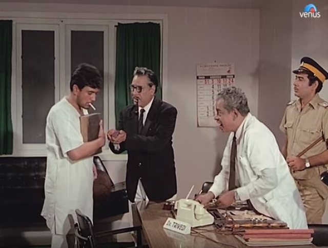 Psychologist and police officers offer Rajesh Khanna's Dilip Roy a cigarette, while treating him like an infant. Because, '<i>pagalpan</i>.'