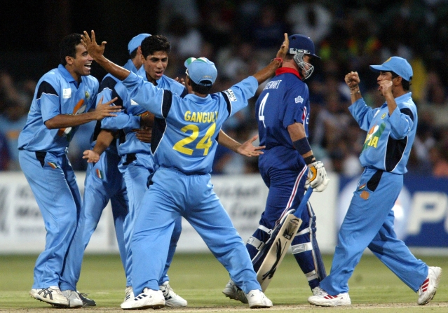 Indian cricketer Ashish Nehra (3rd from L, facing the camera) celebrates with teammates after taking the wicket of England's Alec Stewart (2nd R) during a group A match of the 2003 World Cup.