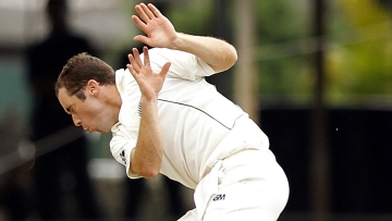 New Zealand's Todd Astle (L) reacts as he tries to duck from the ball during the third day of second and final test cricket match against Sri Lanka in Colombo November 27, 2012.
