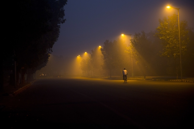 A cyclist pedals through the morning smog a day after Diwali festival, in New Delhi, India, Friday, Oct. 20, 2017.