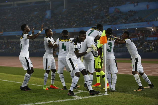 The Ghana players celebrate after scoring a goal against India.