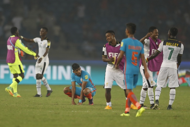 Ghana players celebrate as the Indian players look on after the end of the Group A match.
