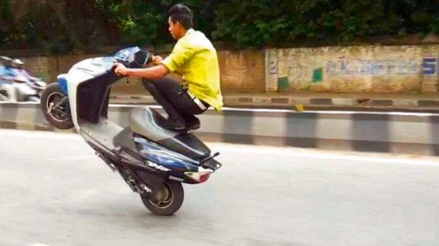 File photo of a youth performing wheelie in Bengaluru.