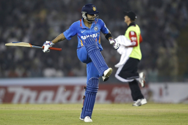 India's Virat Kohli reacts after his dismissal by England's Graeme Swann during their third one-day international match in Mohali on 20 October.