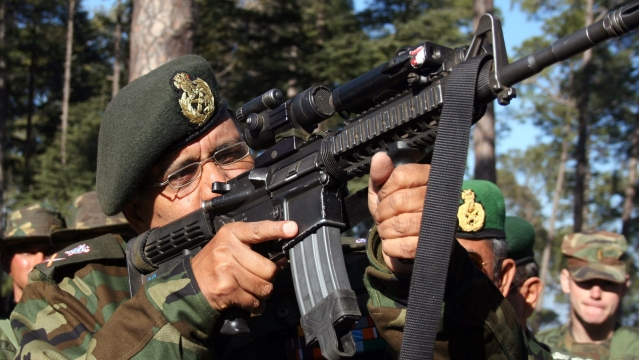 An Indian army officer inspects a US rifle during Indo-US joint exercise in Chaubattia, in the northern Indian state of Uttaranchal, on 26 January 2006. Image used for representational purposes.