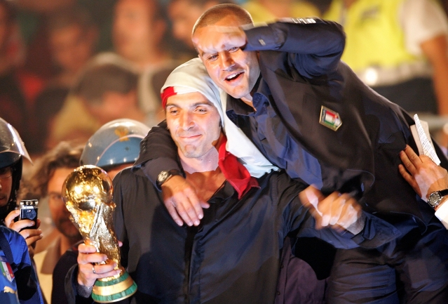 10 July 2006 photo of Gianluigi Buffon (L) and Fabio Cannavaro celebrating with the World Cup  trophy during celebrations at the Circus Maximus in downtown Rome