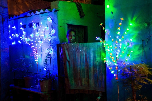 A house decorated with lights during Diwali in Chandrawal basti.