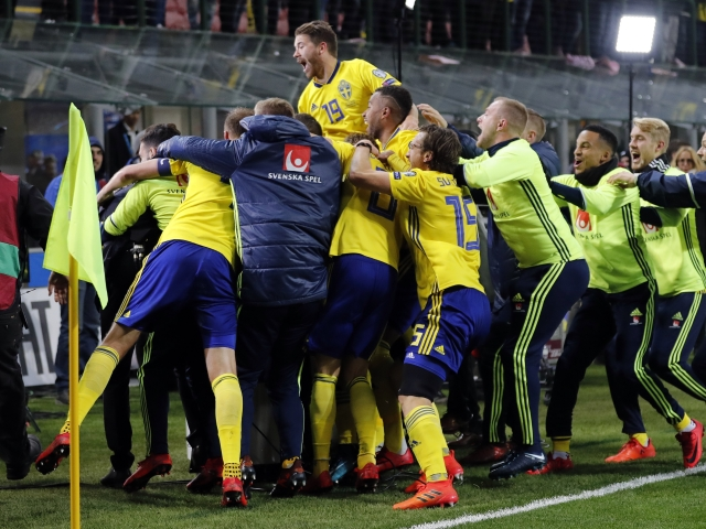 Sweden players celebrate at the end of the World Cup qualifying play-off second leg soccer match between Italy and Sweden, at the Milan San Siro stadium, Italy, Monday, Nov. 13, 2017. Four-time champion Italy has failed to qualify for WorldCup; Sweden advances with 1-0 aggregate win in playoff.<a></a>