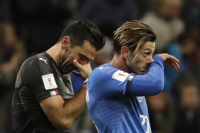 Italy's goalkeeper Gianluigi Buffon, left, and Manolo Gabbiadini react to their team's elimination.