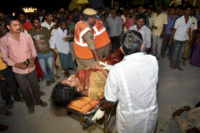 An injured being taken to hospital after an overloaded boat carrying 38 people capsized in the Krishna river near Vijayawada on Sunday evening.