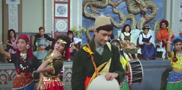 Vyjayanthimala burning up the dance floor as Dev Anand looks on in <i>Jewel Thief.</i>