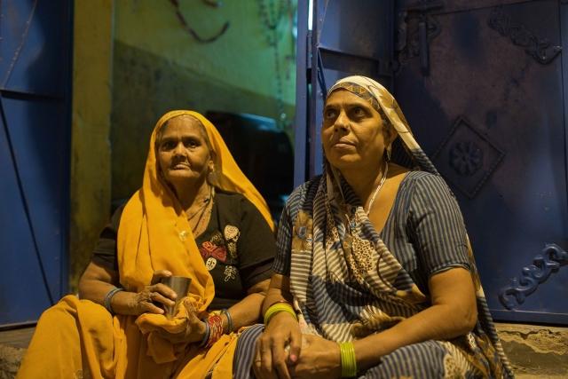 Triveni with one of her neighbors in Kabir Nagar basti, north Delhi.