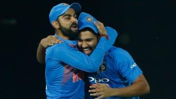 Virat Kohli and Rohit Sharma celebrate during India vs South Africa match.