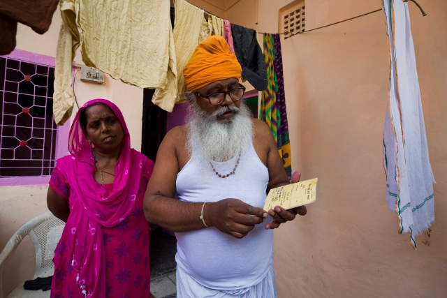 Roshan Lal and Pushpa, his wife, with their yellow card.