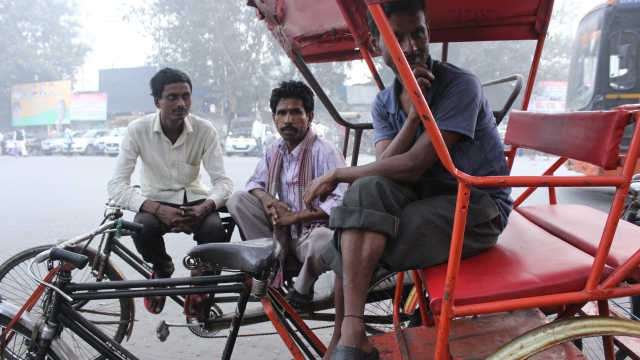 Nazrul (right) and his fellow rickshaw pullers.