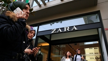 People exit and walk past a fashion retailer Zara branch in an Istanbul upscale neighbourhood.