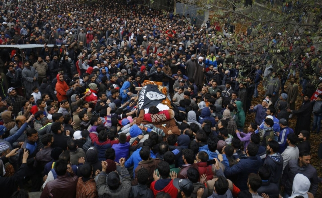 Funeral procession of the militant Mugees Ahmad Mir whose coffin was draped in ISIS flag and carried through Srinagar for burial on Sunday.