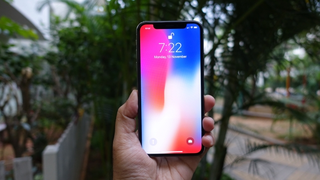 Use Face ID to unlock the iPhone X.