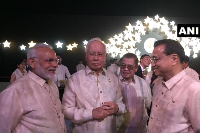 PM Modi with Chinese Premier Li Keqiang and Malaysian PM Najib Razak on the sidelines of the summit.