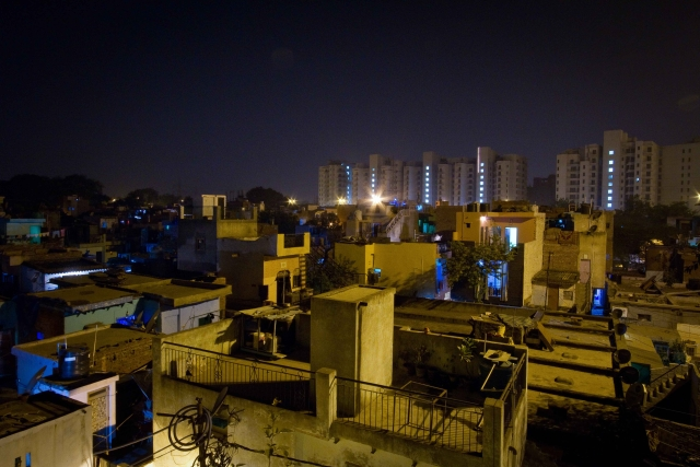 Night view of Chandrawal Basti overlooking the Parsvnath High Towers, North Delhi.