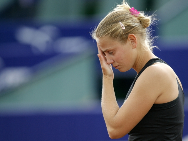 In this May 7, 2009, file photo, tennis player Jelena Dokic reacts during a match against France's Karla Mraz, in Bucharest, Romania.