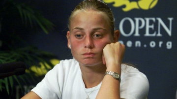 FILE - In this Aug. 31, 2000, file photo, Australia's Jelena Dokic reacts during a news conference at the U.S. Open tennis tournament in New York.