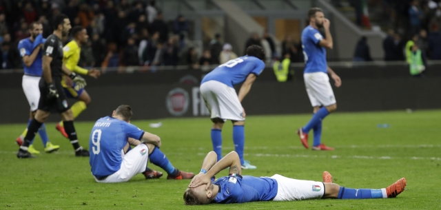 Italy's Ciro Immobile, foreground, and Italy's Andrea Belotti, seated left, react to their team's elimination in the World Cup qualifying play-off second leg soccer match between Italy and Sweden, at the Milan San Siro stadium, Italy, Monday, Nov. 13, 2017.