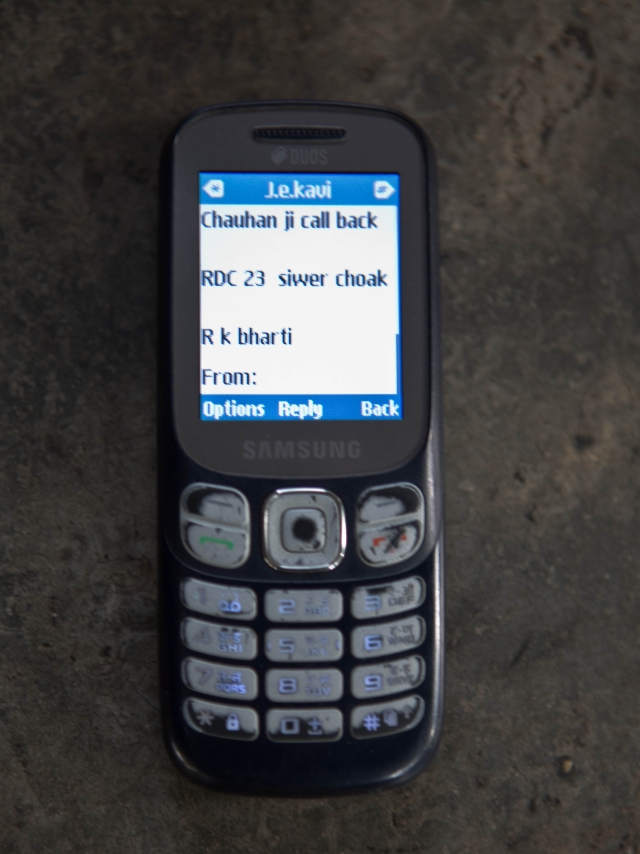 Supervisor Ratender Chauhan is informed via text message about the drains that need to cleaned/unblocked.