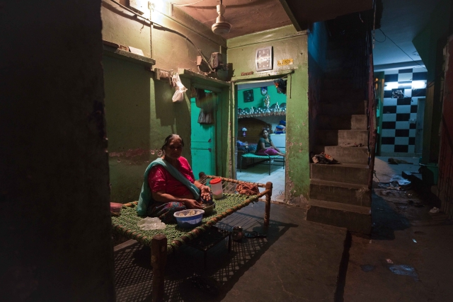 Sharda, who has been a resident of Majnu ka Tila for over three decades, sits in the courtyard of her house. She feels safe after electricity metres have been installed, and can comfortably be seen out till late at night, north Delhi.